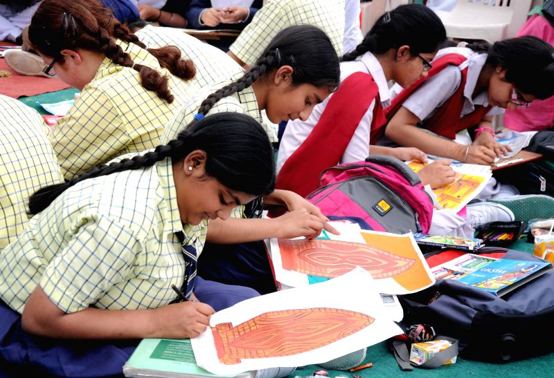 Children during a painting competition organised on the 96th anniversary of Jallianwala Bagh in which hundreds of freedom fighters were gunned down by British in Amritsar on April 13, 2015.