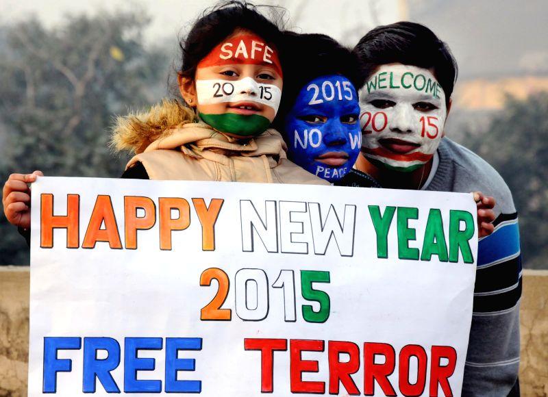 Children wish a terror free 2015 in Amritsar, on Dec 31, 2014.