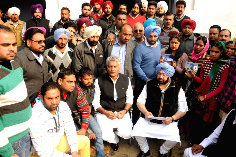 Congress leader and MP from Amritsar Captain Amarinder Singh meets relatives of Indian workers who were taken hostage in Iraq in Amritsar on Dec. 13, 2014.