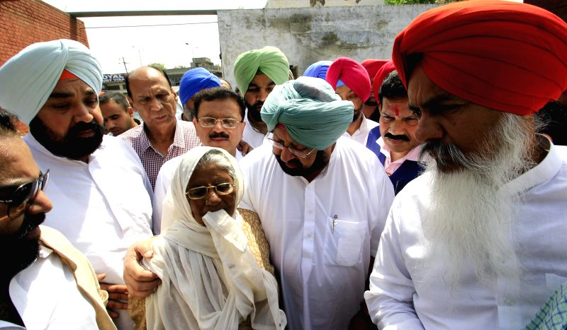 Congress MP Capt Amarinder Singh visits the bereaved family members of Joginder Singh, a septuagenarian farmer who died at the site of a farmers' demonstration at Devidaspura on 28th April; ... - Capt Amarinder Singh