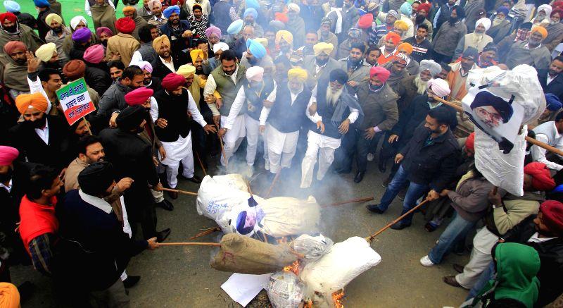 Congress workers burn effigy of Punjab Deputy Chief Minister Sukhbir Singh Badal during a protest in Amritsar on Jan. 5, 2015. - Sukhbir Singh Badal
