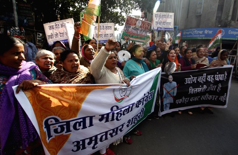 :Amritsar: Congress workers stage a demonstration against Union Budget 2018-19, in Amritsar on Feb 2, 2018. (Photo: IANS).