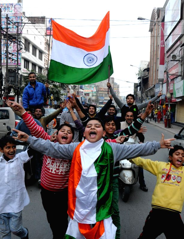 Cricket fans celebrate India's victory over Pakistan in an ICC World Cup 2015 match, in Amritsar, on Feb 15, 2015.