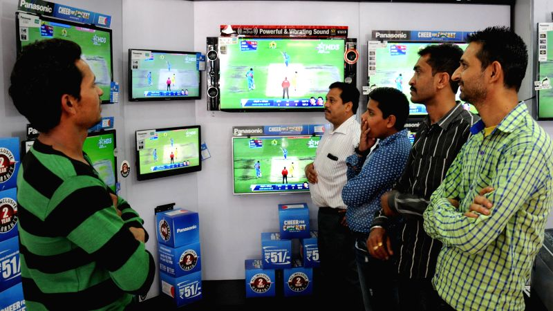 Cricket fans glued to the television sets during the semifinal match of ICC World Cup 2015 between India and Australia in Sydney, at an electronics showroom in Amritsar on March 26, 2015.