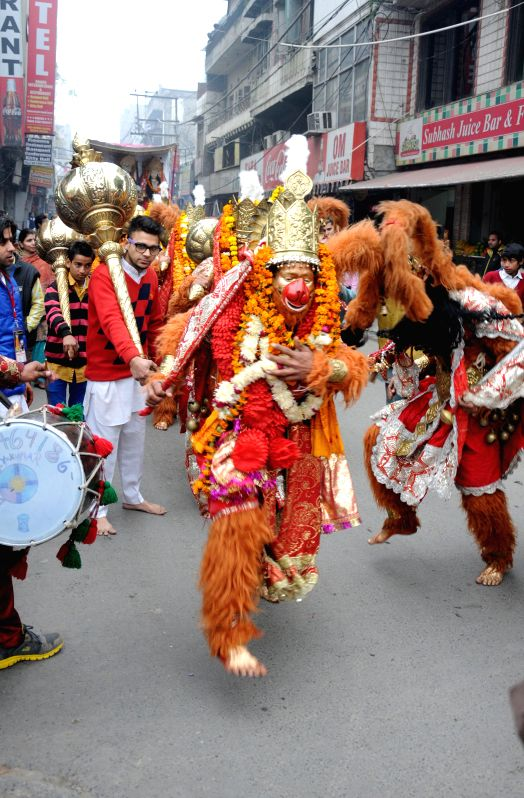 Devotees disguised as Lord Hanuman participate in a procession organised on the birth anniversary of  Baba Lal ji in Amritsar, on Jan 20, 2015.