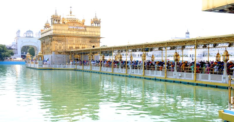 Devotees paying obeisance at Golden Temple on occasion of 394th birth anniversary  of the ninth Sikh Guru Teg Bahadur in Amritsar on April 9, 2015.