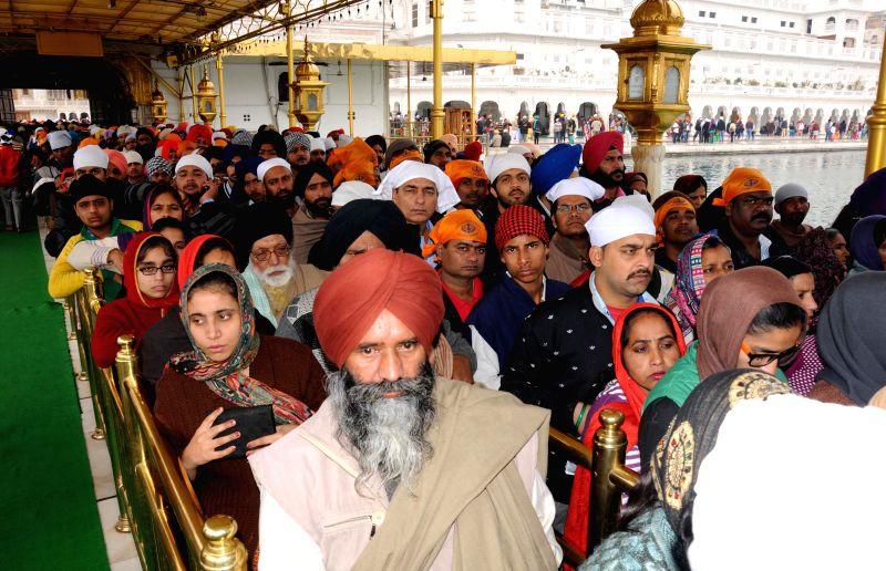 Devotees throng the Golden Temple on Makar Sankranti in Amritsar on Jan 14, 2015.