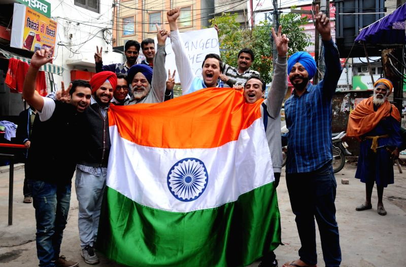 Fans celebrate after India defeated South Africa in an ICC World Cup 2015 match played at Melbourne Cricket Ground, in Amritsar on Feb 22, 2015.