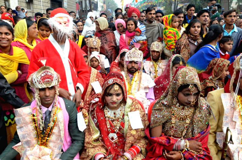 Fifty one couples marry at a mass marriage programme in Amritsar, on Dec 25, 2014.