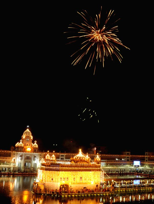 Fireworks light up the sky above the Golden Temple on the birth anniversary of Guru Tegh Bahadur - the ninth Sikh Guru in Amritsar, on April 9, 2015.