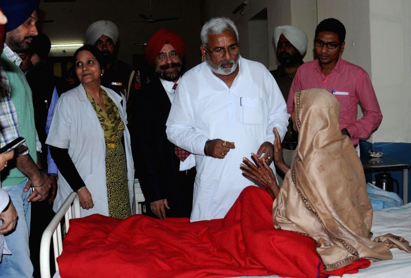 Health Minister Surjit Kumar Jyani meet the patients who have lost their vision during a free eye camp held at Ghuman in Gurdaspur district, at Eye and ENT hospital on Saturday in Amritsar .