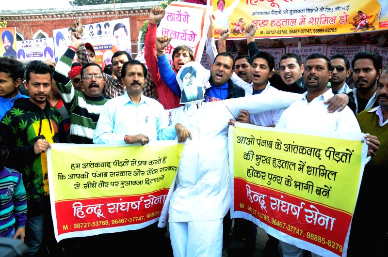 Hindu Sangharsh Sena activists stage a demonstration in Amritsar, on Nov 23, 2014.
