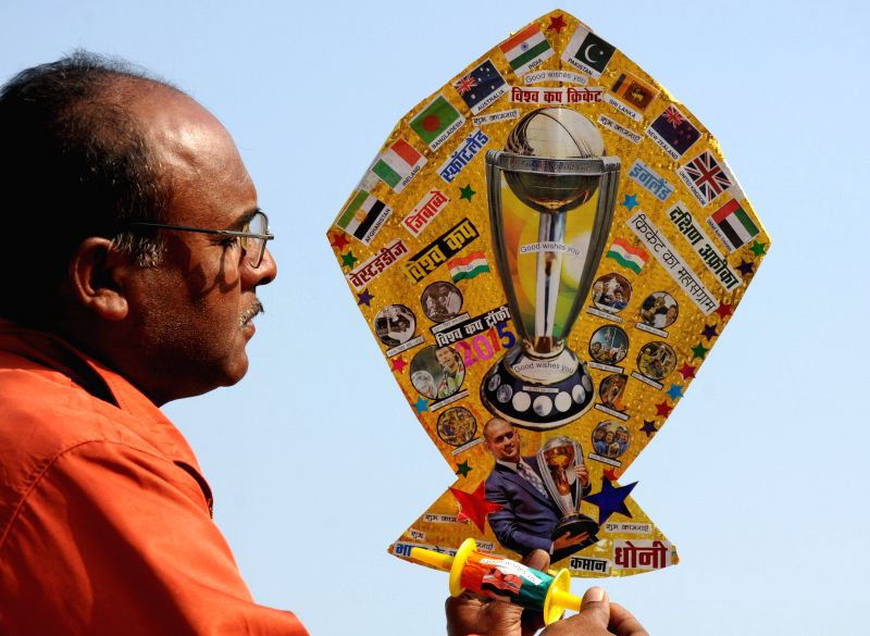 Kite-maker Jagmohan Kanojia shows a kite bearing the flags of all the 14 countries participating in ICC world cup 2015 in Amritsar on Feb 12, 2015.