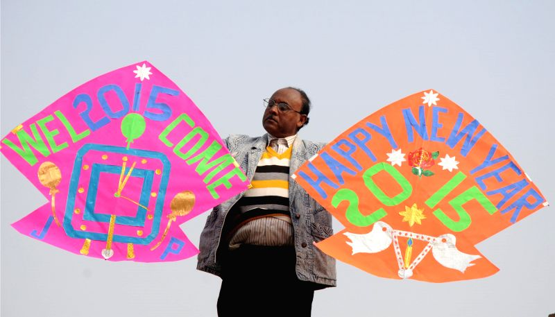Kite maker Jagmohan Kanojia welcomes 2015 with his kites in Amritsar, on Dec 31, 2014.