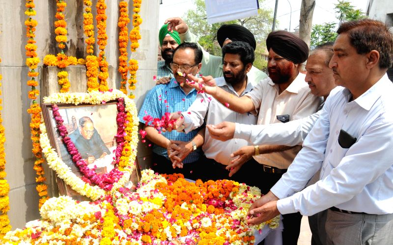 Members of Guru Ravidass welfare society pay homage to the statue of Babasaheb Dr. B.R. Ambedkar on the occasion of his 124th birth anniversary in Amritsar on April 14, 2015.