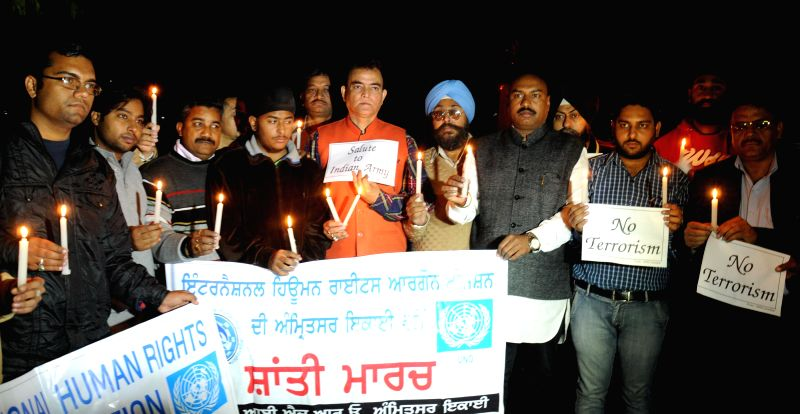 Members of International Human Rights Organisation hold a candlelight vigil to condemn the Maoist attack on CRPF soldiers in Chhatisgarh; in Amritsar, on Dec 2, 2014.