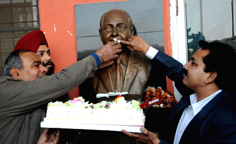 Members of Mohammad society celebrate the 90th birth anniversary of singer Mohammed Rafi in front of his statue on Dec 24, 2014.