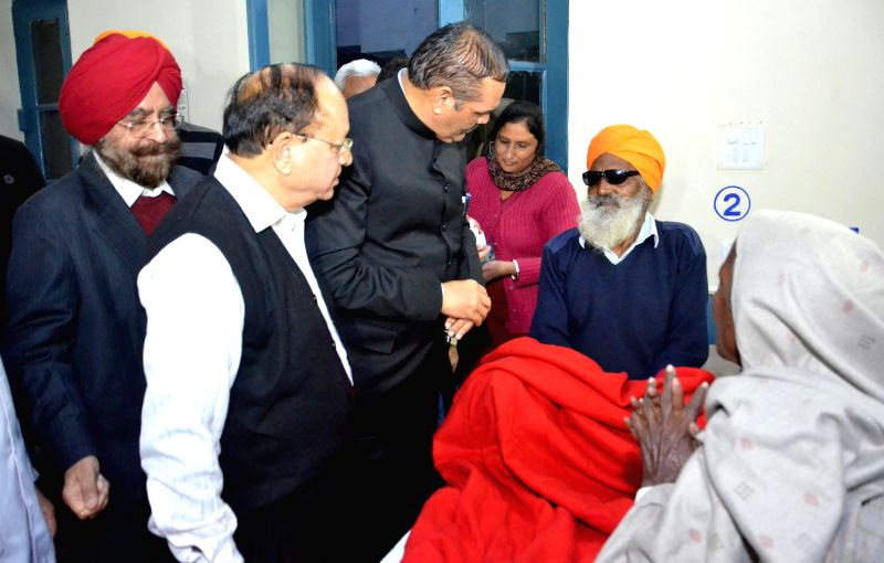 Minister of State for Social Justice and Empowerment Vijay Sampla meet the patients who have lost their vision during a free eye camp held at Ghuman in Gurdaspur district, at Eye and ENT ...