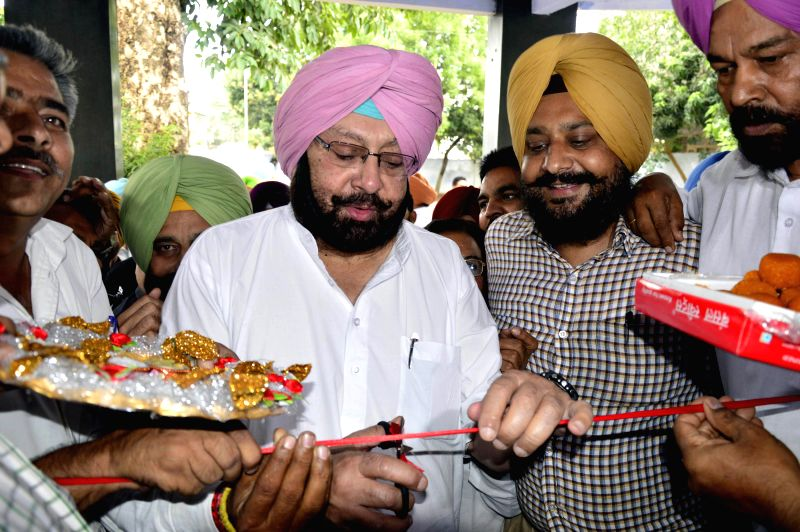Amritsar MP and Congress leader Captain Amarinder Singh inaugurates a party office in Amritsar  in Amritsar on June 25, 2014.