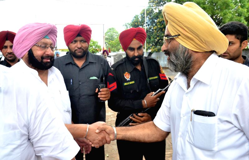 Amritsar MP and Congress leader Captain Amarinder Singh interacts with party leaders  in Amritsar on June 25, 2014.