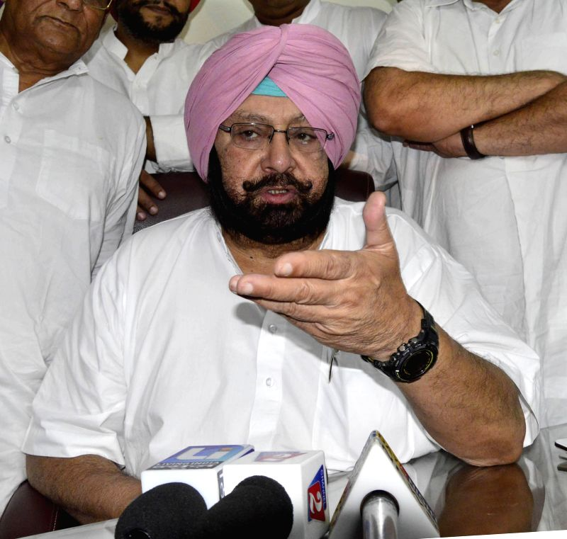 Amritsar MP and Congress leader Captain Amarinder Singh addresses press in Amritsar on June 25, 2014.