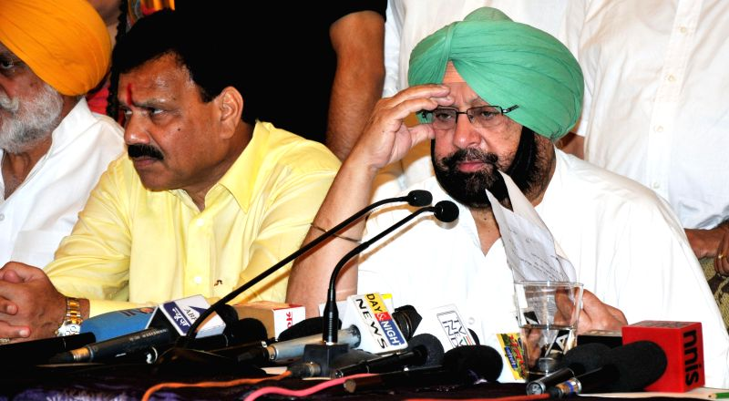 Amritsar MP and Congress leader Captain Amarinder Singh addresses a press conference in Amritsar on June 26, 2014.