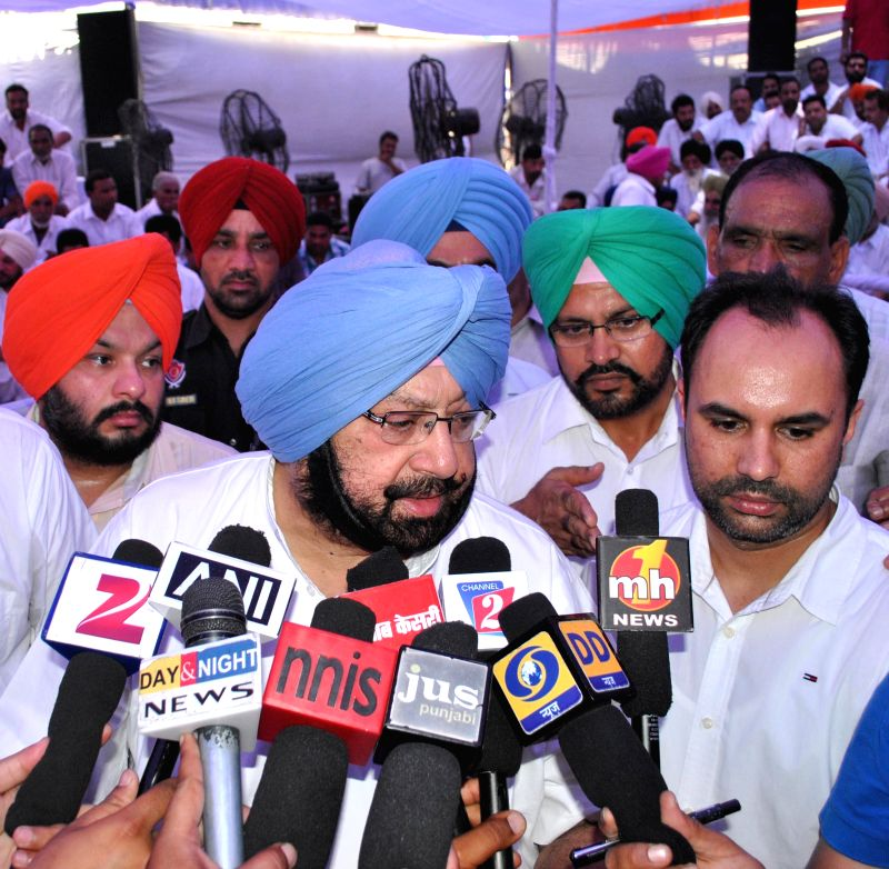 Amritsar MP and Congress leader Captain Amarinder Singh addresses press during a programme in Amritsar on June 27, 2014.