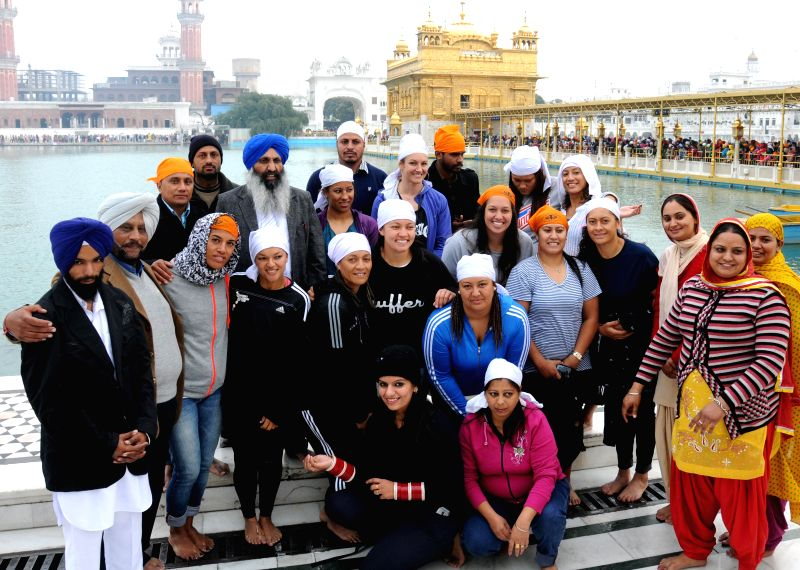 New Zealand women`s Kabaddi team pay obeisance at Golden Temple in Amritsar  on Dec. 13, 2014.