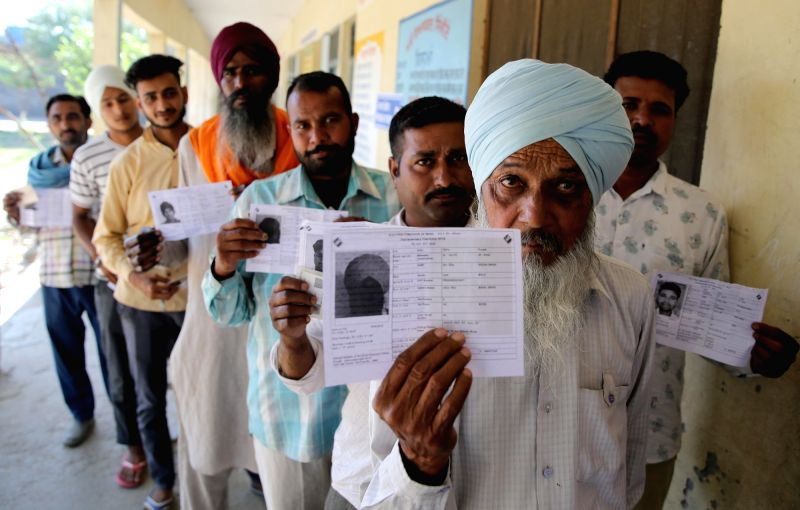 Amritsar: People queue up to cast their vote during the seventh and the last phase of 2019 Lok Sabha Elections at a polling booth in Amritsar on May 19, 2019. (Photo: IANS)