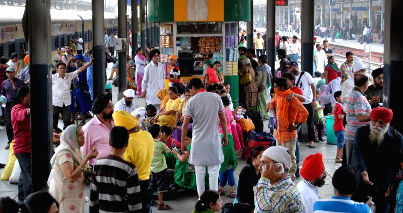 People remain stranded at Amritsar railway station as railway services were disrupted after farmers blocked railway tracks to press for their various demands including relaxation in ...