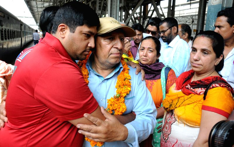 People stuck in earthquake hit Nepal being received by their relatives as they arrive in Amritsar on April 27, 2015.