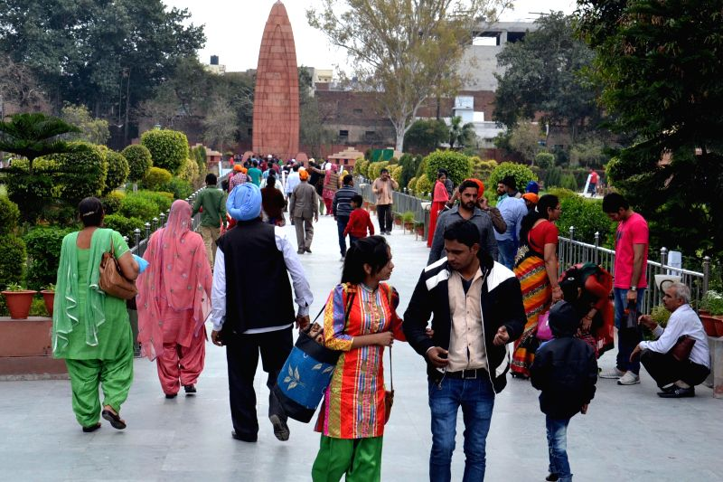 People visit at Jallianwala Bagh in Amritsar on Feb 28, 2015. Union Finance Minister Arun Jaitley has proposed to provide resources to start work of landscape restoration, signage and ... - Arun Jaitley