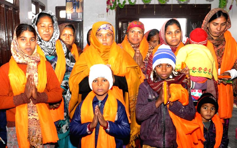 People who had embraced Christianity pay obeisance at Guru Ki Wadali Gurdwara before converting back to Sikhism in Amritsar on Dec 30, 2014.