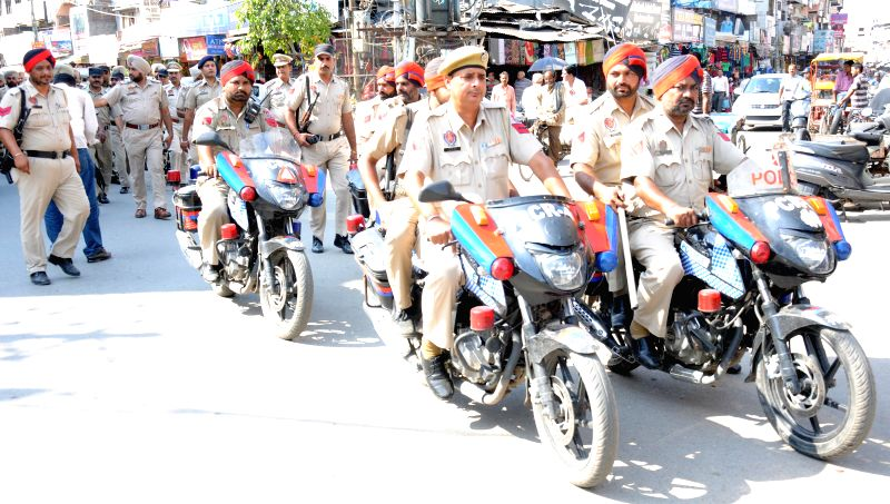 Policemen conduct a flag march on the eve of Operation Bluestar in Amritsar, on June 5, 2015.