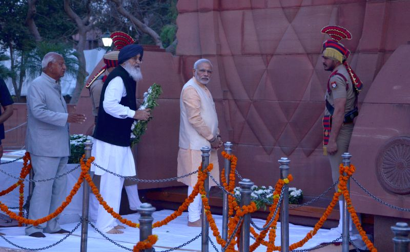 Prime Minister Narendra Modi pays tribute at Jallianwala Bagh in Amritsar, on March 23, 2015. - Narendra Modi