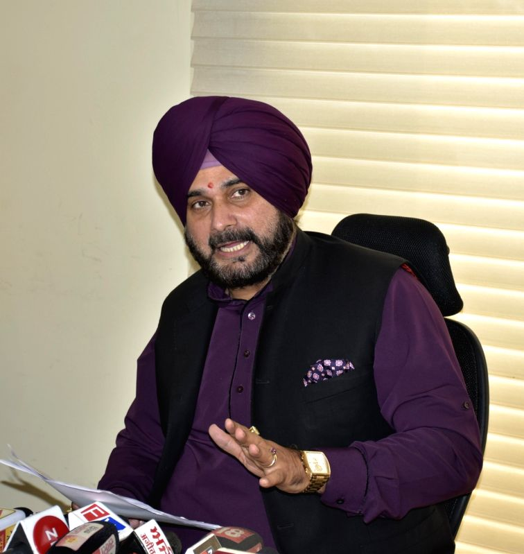 : Amritsar: Punjab Cabinet Minister Navjot Singh Sidhu addresses a press conference, in Amritsar on Oct 10, 2018. .