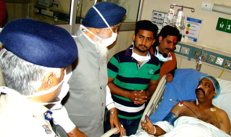 Punjab Chief Minister Parkash Singh Badal with Punjab DGP Sumedh Saini meets hospitalized Punjab Shiv Sena General Secretary Harvinder Soni, who was attack in Gurdaspur, in Amritsar on ... - Parkash Singh Badal