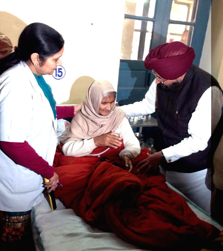 Punjab Congress President Partap Singh Bajwa meets a patient who lost his vision after undergoing an eye surgery at an eyecamp organised by an NGO in Gurdaspur district of Punjab being ...