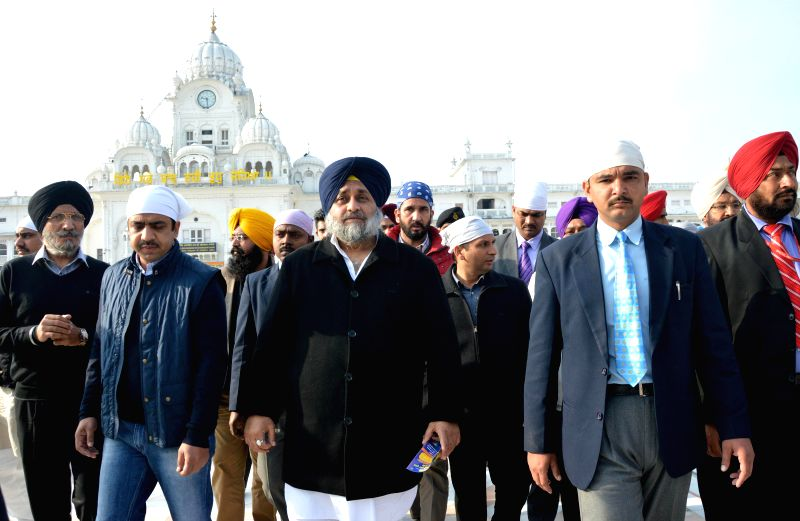 Punjab Deputy Chief Minister Sukhbir Singh Badal pays obeisance at the Golden Temple in Amritsar on Feb 8, 2015.