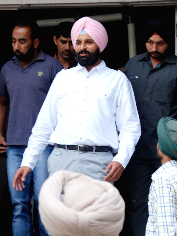 Punjab Minister Bikram Singh Majithia comes out after appearing before an Amritsar court on April 27, 2015.