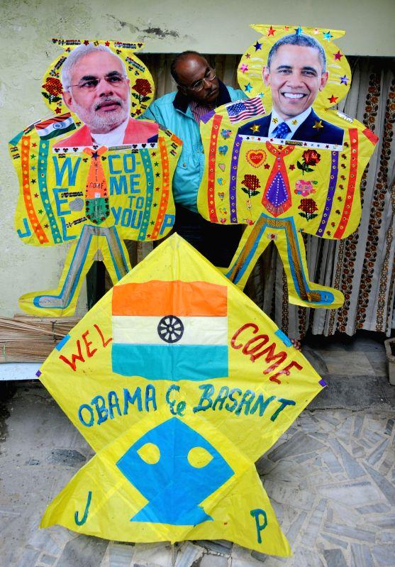 Renowned kite maker Jagmohan Kanojia shows his special kites with the photographs of Prime Minister Narendra Modi and US President Barack Obama in Amritsar, on Jan 21, 2015. - Narendra Modi