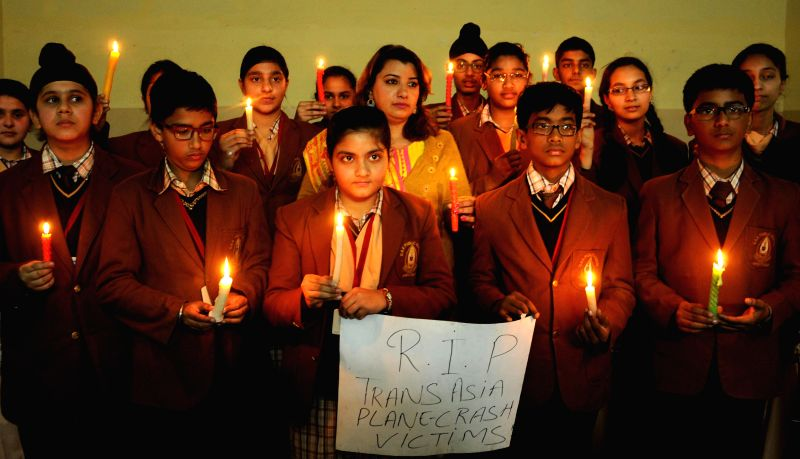 School children pays homage to the victims of Taiwanese TransAsia Airways plane crashed into a river near Taipei in Amritsar, on Feb 4, 2015. At least 13 people reported killed and 27 ...
