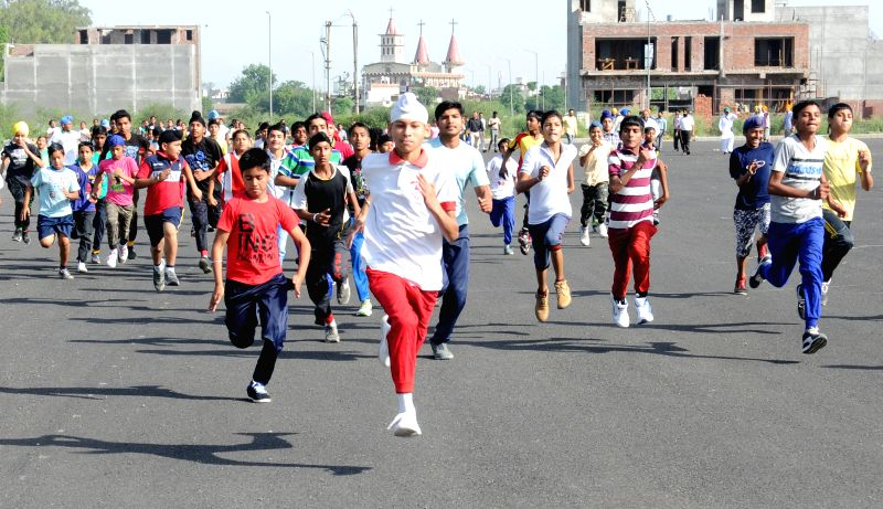 School students participate in a marathon organised in Amritsar on May 1, 2015.