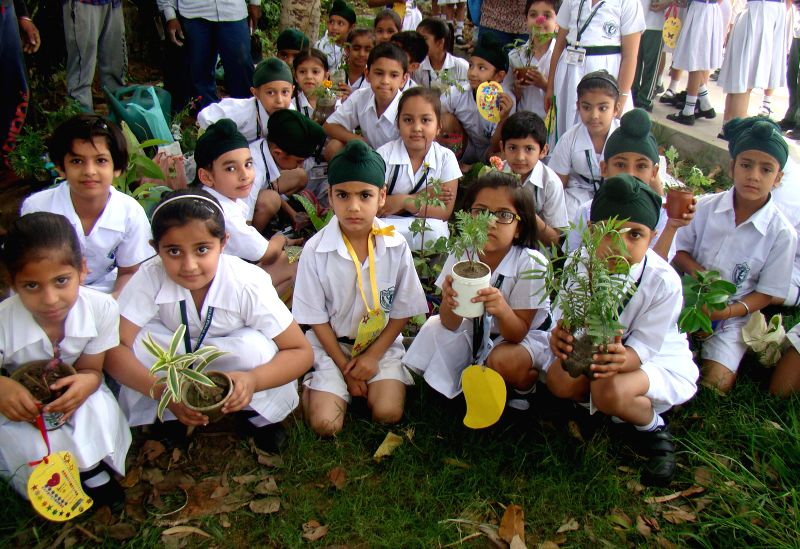 School students plant saplings on `World Earth Day` in Amritsar, on April 22, 2015.