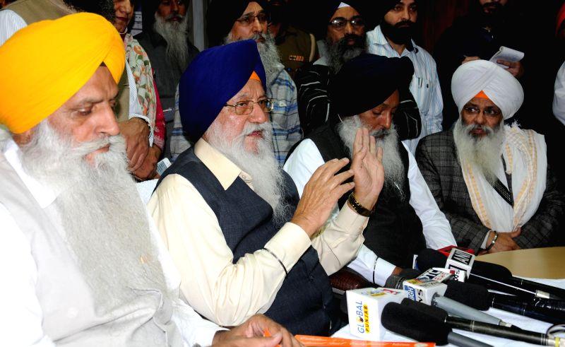 SGPC president Avtar Singh Makkar addresses a press conference regarding International Educational Conference, in Amritsar, on Dec 1, 2014. - Avtar Singh Makkar