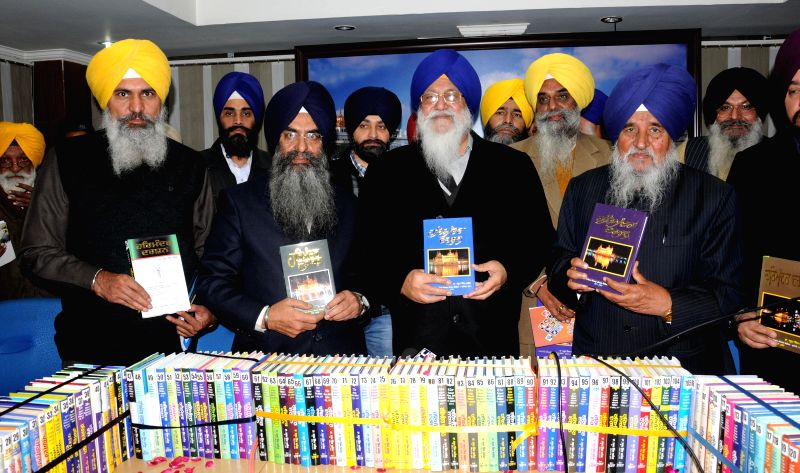 SGPC president Avtar Singh Makkar releases  `Harmandir Darshan` - a book on the history of Golden Temple in Amritsar, on Dec 23, 2014. - Avtar Singh Makkar
