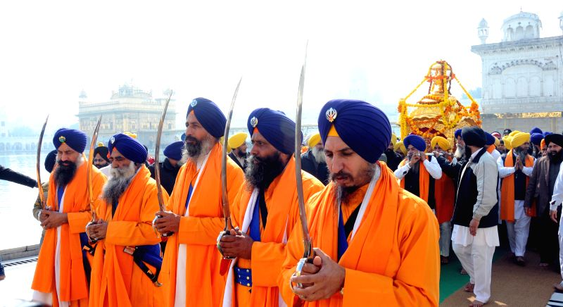 Sikh devotees carrying the palanquin during a religious procession in Golden Temple  ahead of birth anniversary of Baba Deep Singh in Amritsar on Jan. 24, 2015. - Deep Singh