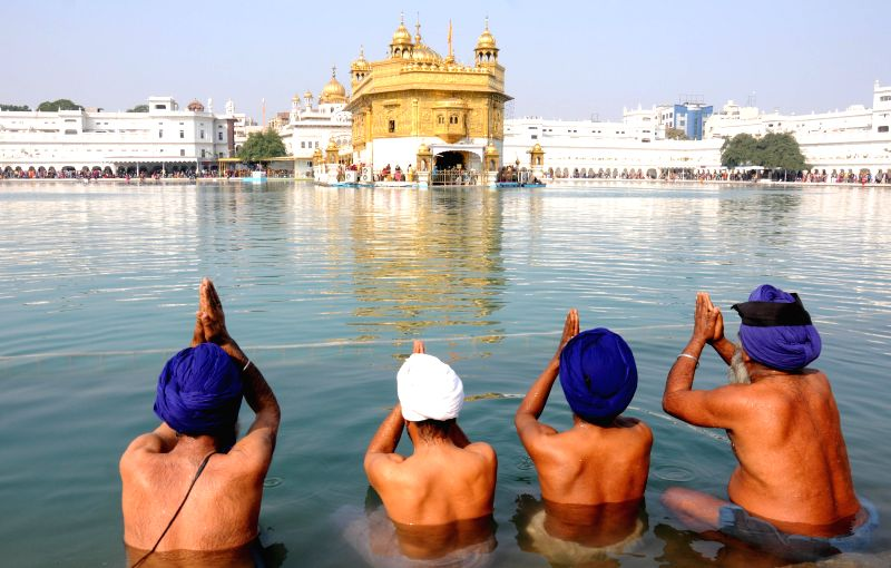 Sikhs pay obeisance at the Golden Temple on new year in Amritsar, on Jan 1, 2015.