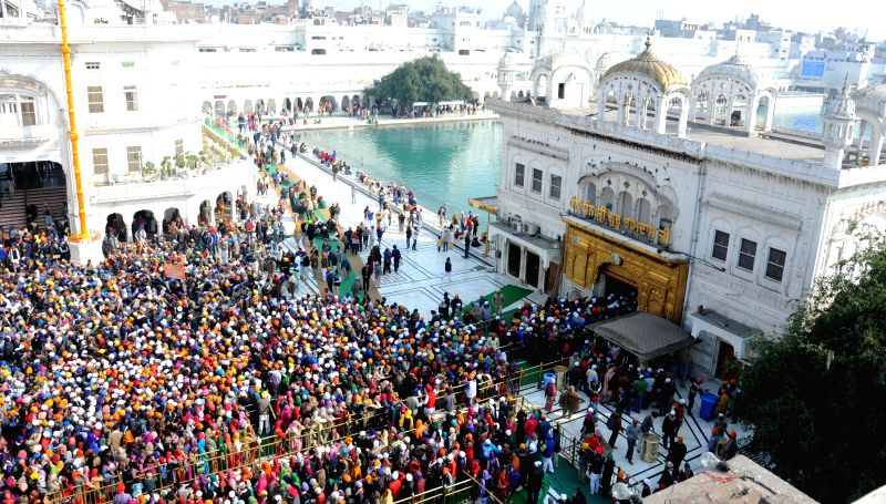 Sikhs throng the Golden temple on the first day of the new year in Amritsar, on Jan 1, 2015.