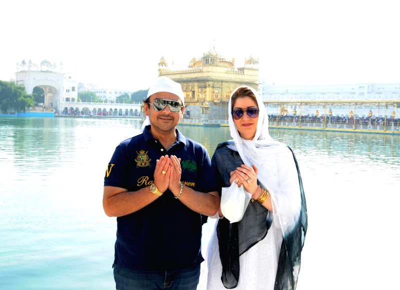 Singer and composer Adnan Sami and his wife Roya Faryabi pays obeisance at the Golden Temple in Amritsar on Dec 4, 2014.